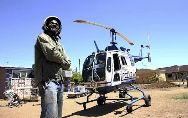 Chebanga poses next to his helicopter replica. Photo: Times Live