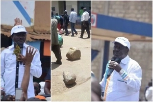 Raila and Kalonzo bump into hostile crowd, forced to abort venue