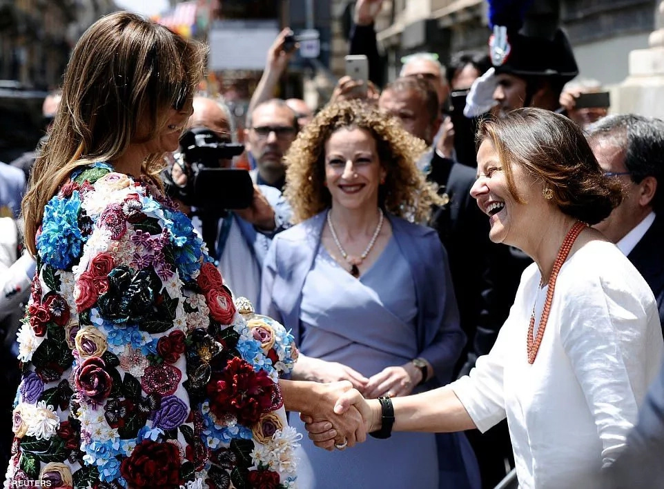 Melania is welcomed by Emanuela Mauro, wife of Italian Prime Minister Paolo Gentiloni