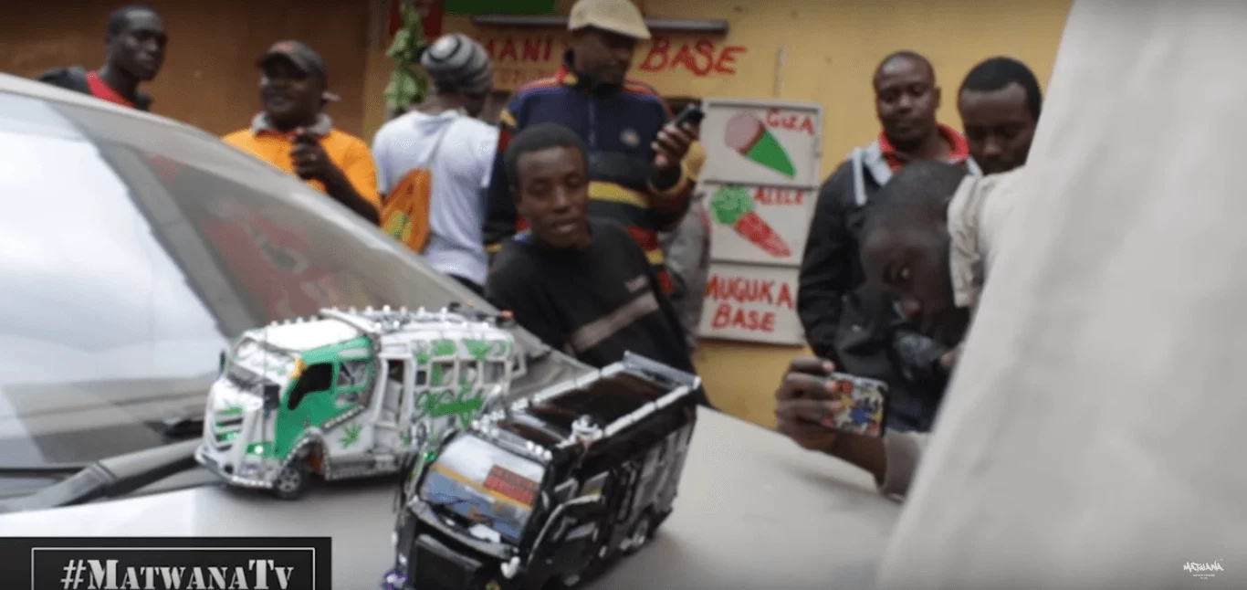 J.J sells the toy matatus to supplement the income he gets as a conductor
