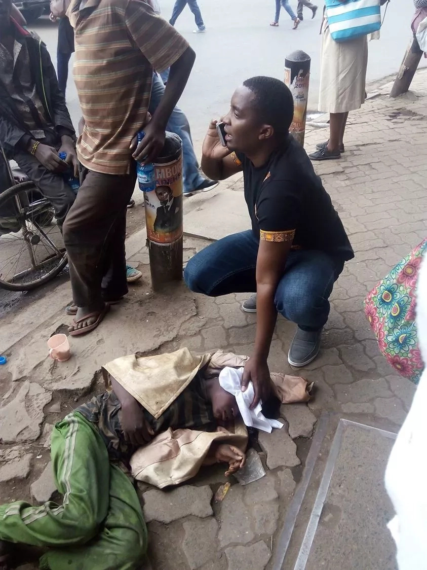 Man becomes instant celebrity by saving a street boy from death(photos)