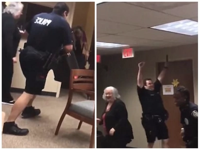Terrified cop screams as he battles to remove snake that had slithered into his office