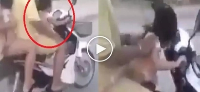Buwis buhay: Irresponsible parents force helpless girl to take control of motorbike on the road
