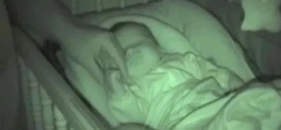 Parents filmed on a hidden camera their baby then they saw this (photos, video)