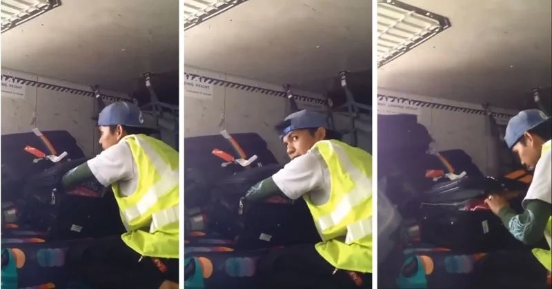 Video captures airport porter opening and searching luggages