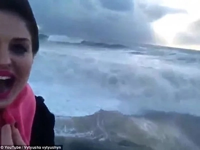 Oh My Word! Watch This Woman Get Taken Out By The Sea!