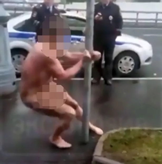 Naked guy handcuffed to a pole displays hilarious strip dancing skills