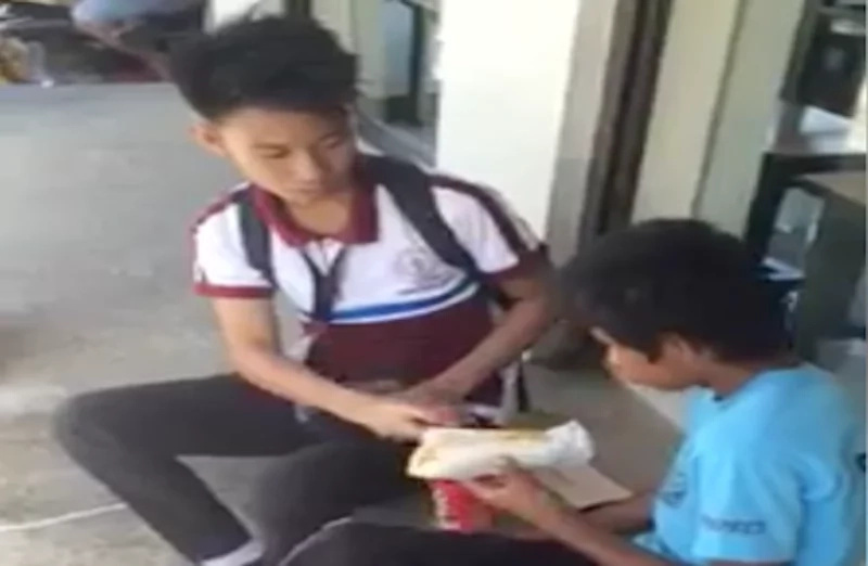 Good deed done by a student who gives his lunch to a hungry homeless boy