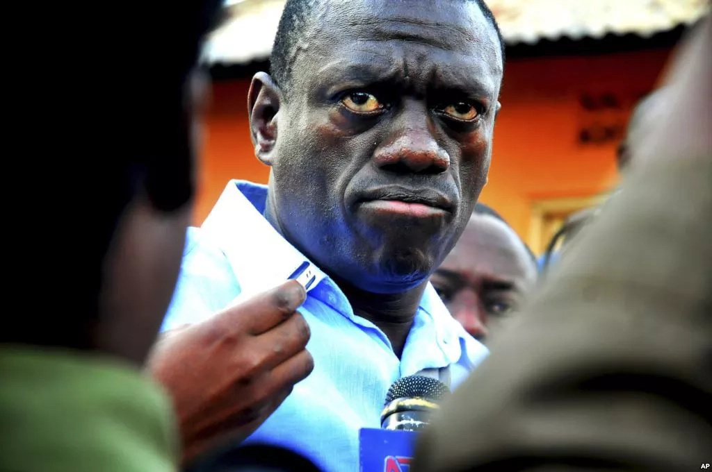 Kizza Besigye arrested inside KQ plane in Uganda