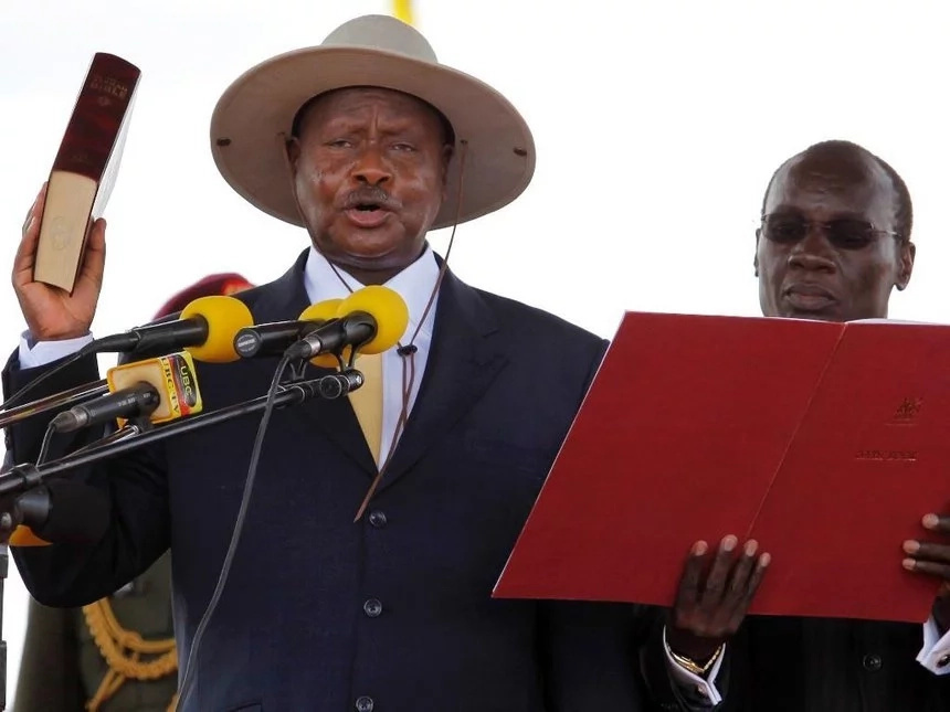 Museveni signs the controversial age limit Bill into law, amid protestation