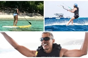 Holiday mode! Barack and Michelle Obama pictured swimming on EXOTIC island (photos)