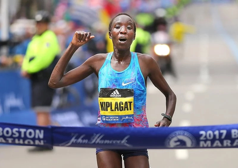 Edna Kiplagat crosses the finish line to win the Boston Marathon for the first time