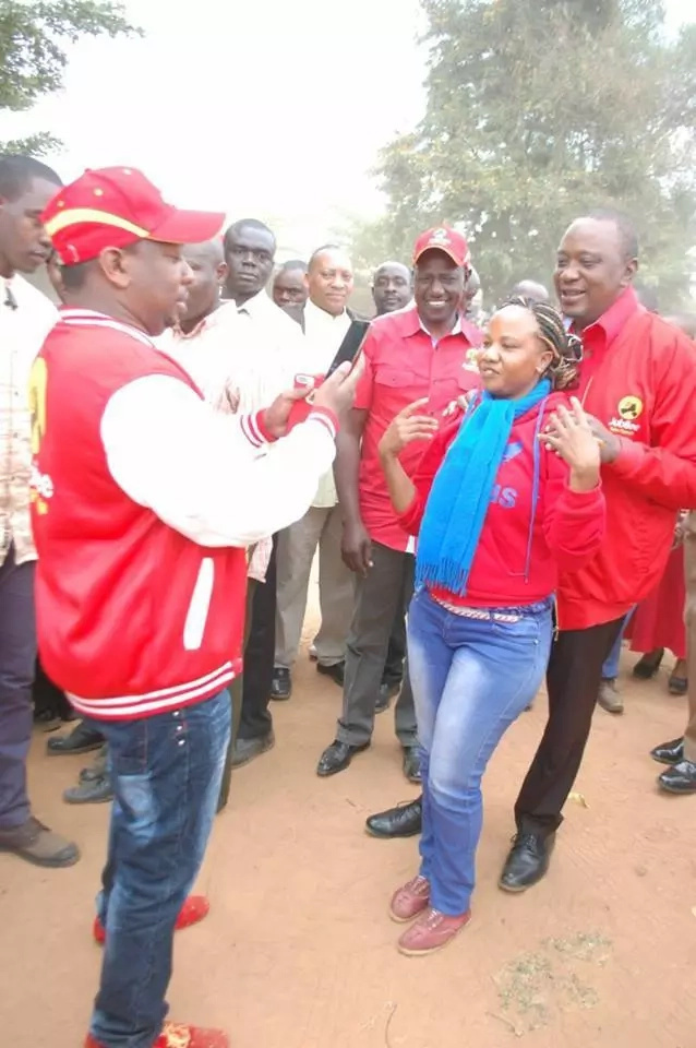 Photo of the day: Uhuru on a lady's shoulders as Mike Sonko takes photos