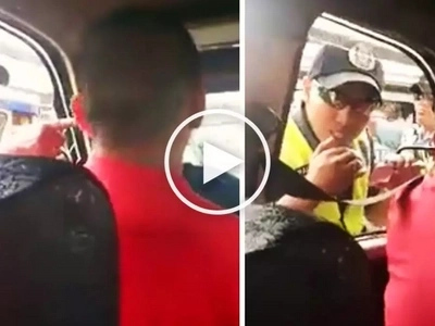 Violent Pinoy policeman stops harassing innocent taxi driver after seeing video camera