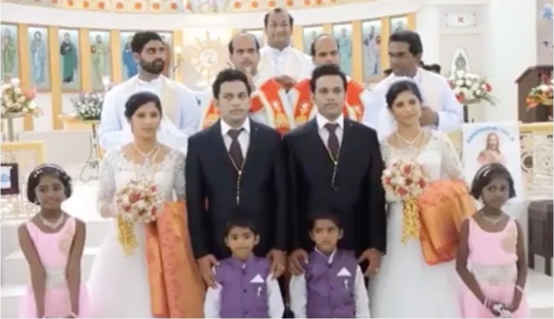 Twin brides marry twin grooms in wedding with twin priests and twin flower girls