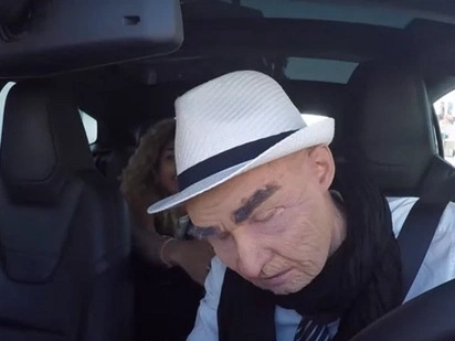 Taxi passengers are shocked when their old driver falls asleep