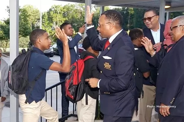 Encouraging! Black empowerment group gives students returning to school a warm welcome