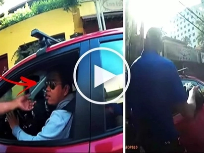 Watch this Pinoy driver attempt to run over traffic enforcers who apprehended him for allegedly beating the red light! What a terrifying video!