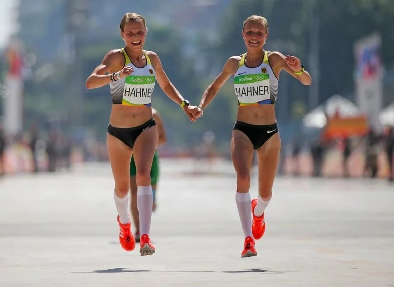 Twin cross the finish line hand-in-hand on the Olympics