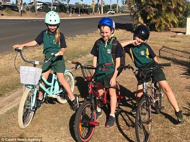 Scare as giant 3-meter python blocks school children riding their bikes on their way home