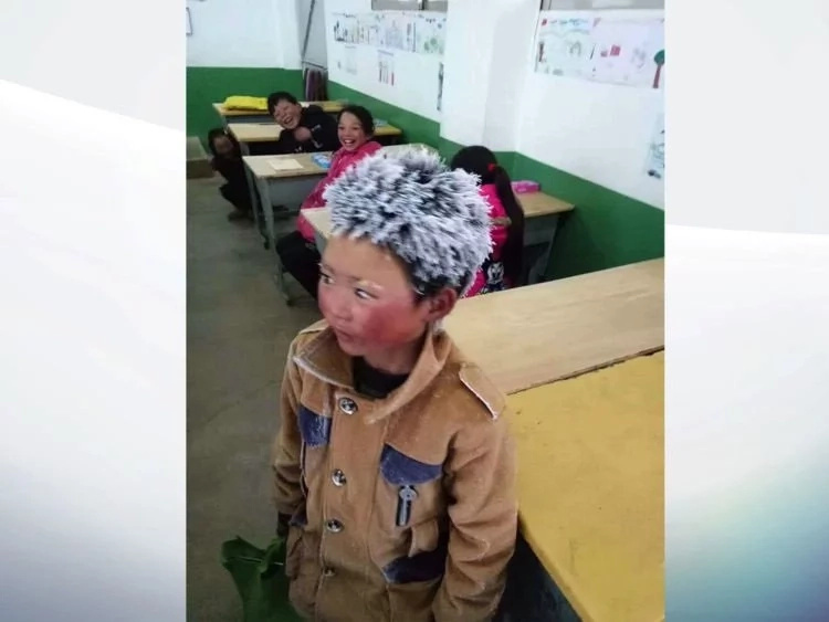 "More than $15,300 in donations for viral ""Ice Boy"" with frozen hair"