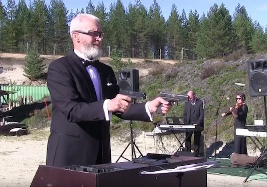 Crazy Russian guy's favorite musical instruments are his guns