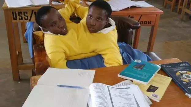 Maria (left) and Consolata have defied the odds to stay in school