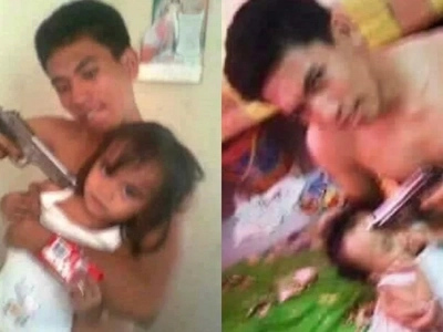 Living the thug life! Arrogant Pinoy angers netizens with his pictures of children at gunpoint