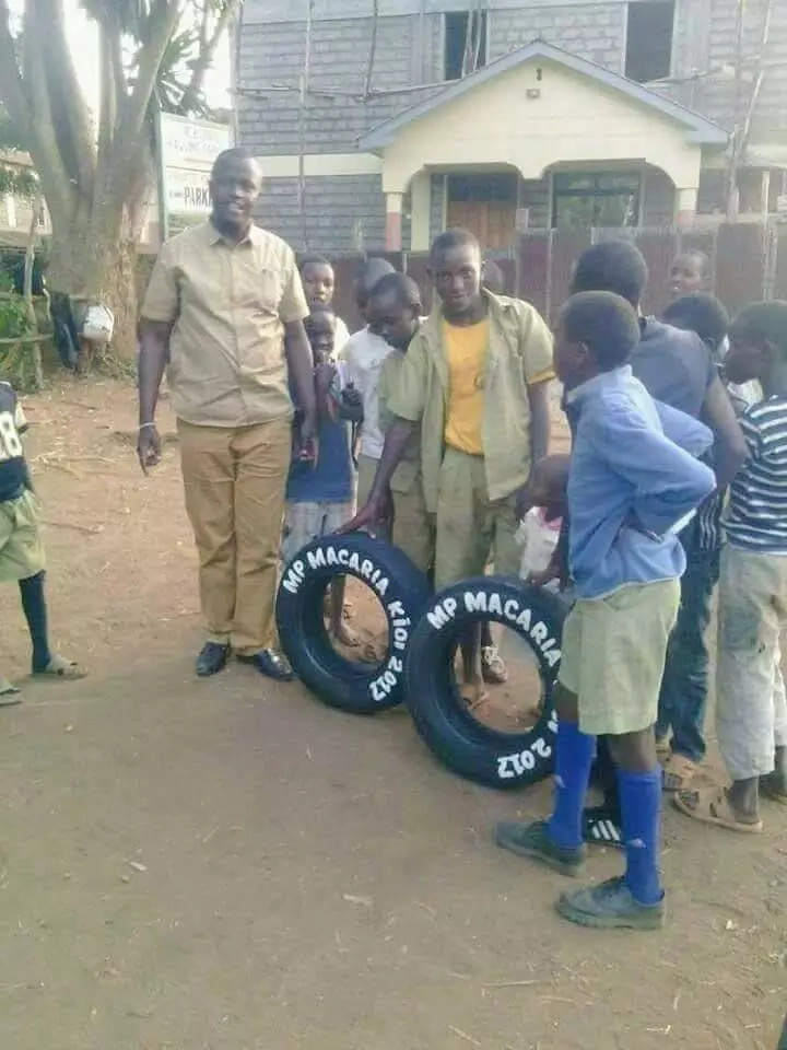 SHAME! Jubilee MP aspirant donates used car tyres to school children (photo)