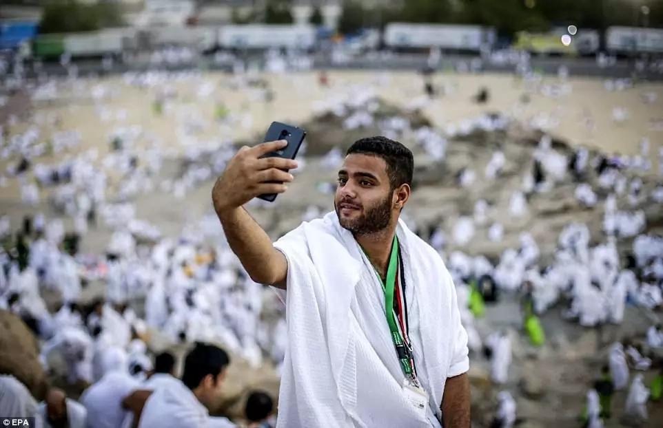 A pilgrim takes a selfie. Photo: EPA