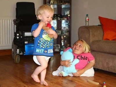 Meet the toddler TWICE the size of his mother and could crush her with his hugs