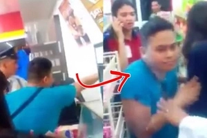 Caught on camera: Cashier hit customer back with milkshake after the customer threw him the loaf bread!