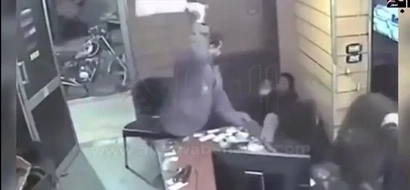 Never Bring A Cleaver To A Chairfight: Crazy Guy Attacks People With Meat Cleaver