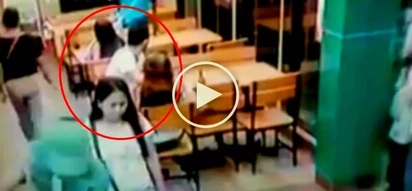 Sneaky Pinoy thieves steal smartphone from unsuspecting customer at fast food restaurant