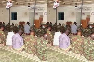 Fearless KDF soldiers bow down to GOD in the battle ground
