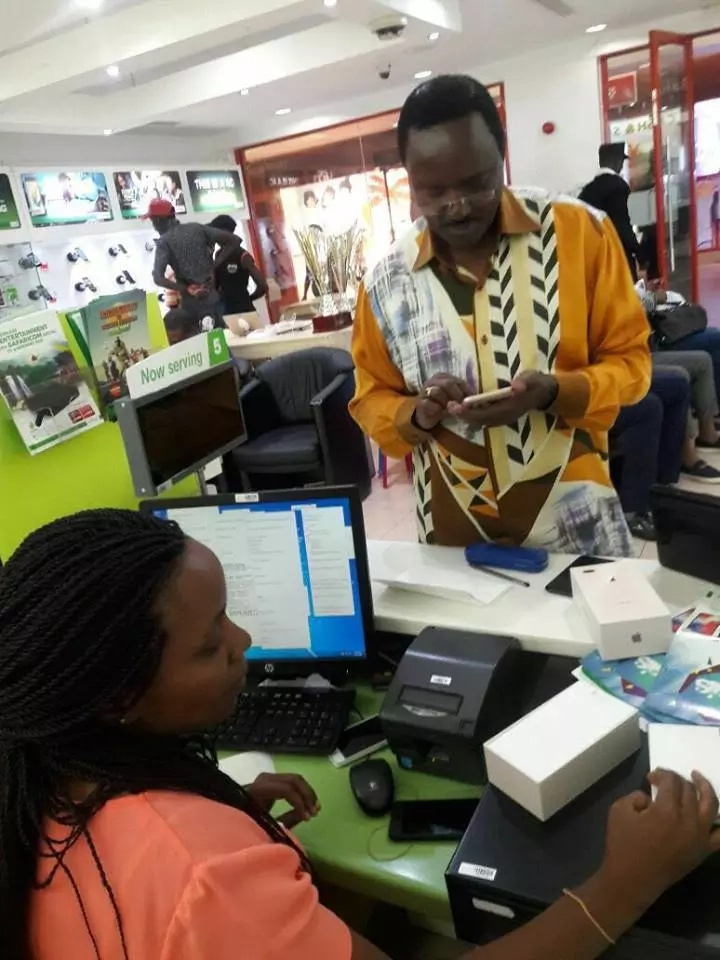 Kalonzo fails to resist as he is seen in a Safaricom shop purchasing a phone