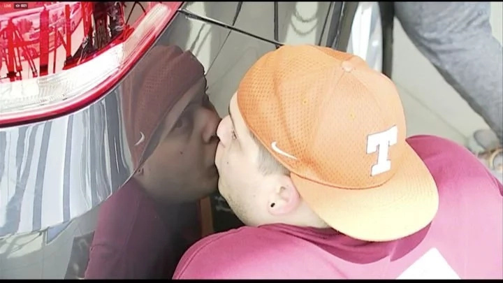Woman wins brand new car after kissing it for 50 HOURS non-stop in smooching contest (photos)
