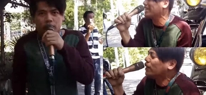 Call center agent grabs microphone and sings in public. It was just like his own concert