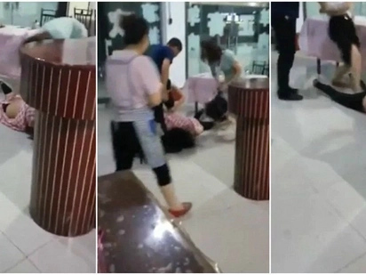 Bizarre moment Chinese mistress attacked by two furious wives in a restaurant