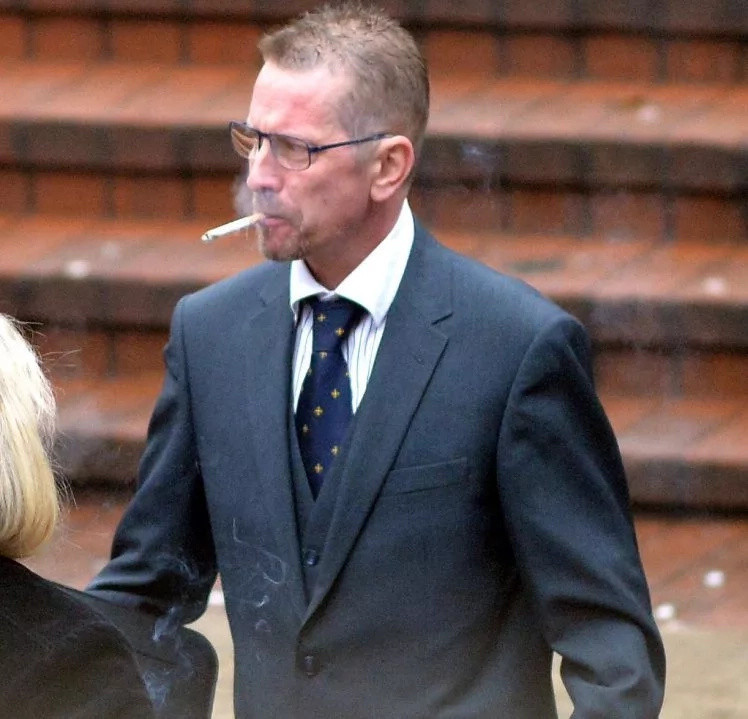 Can't kick the habit: John Cox pictured enjoying a puff outside the court during his hearing