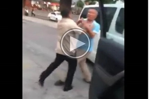 Driver punches another driver in new viral road rage video