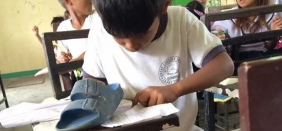 This poor student uses his SLIPPER as eraser