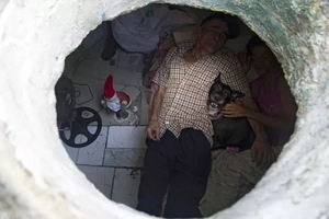 Resilient couple live in sewers for 22 years but their home will leave you speechless