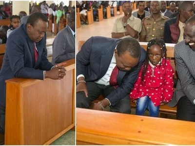 Uhuru takes a moment to kneel down in prayer but there is something different