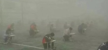 Chinese school principal suspended after forcing students to write exams in thick smog