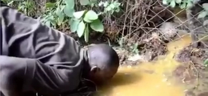 VIDEO: New Low As Men Lick From The Ground Poured Illicit Brew