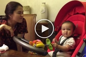 Adorable baby Zia shows her cute 'rat face' in front of the camera