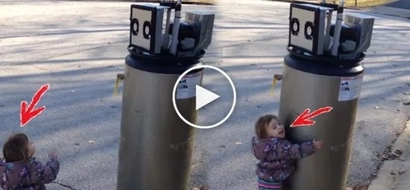 """This adorable toddler thinks discarded water heater is a robot. Now her 'I wuv u robot"""" is melting hearts around the world!"""