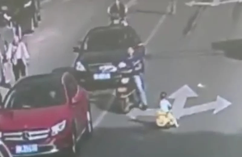 Toddler rides bike in the middle of the road and almost dies