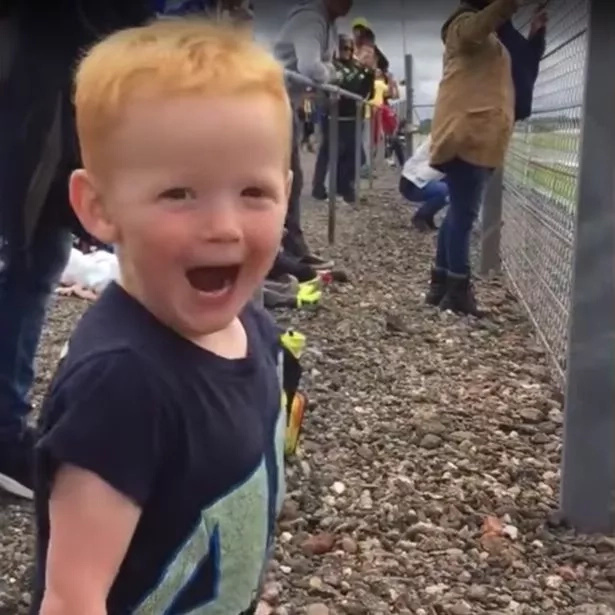 This kid's reaction to a motorcycle is adorable